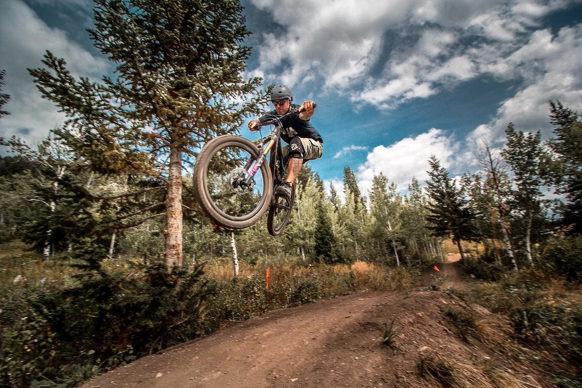 Biker getting air on a bike trail