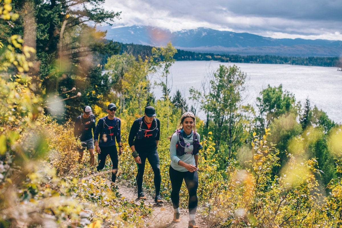 Hikers smiling on a trail in Jackson Hole